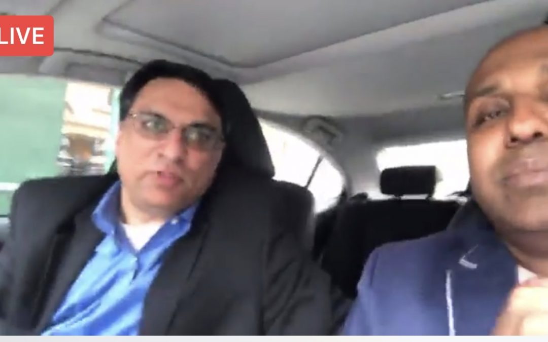Why are these men sitting in a car in NYC? and Live on Facebook with the Global community?